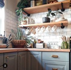 Grey cabinets. Open shelving. Subway tile l. Wood countertop.