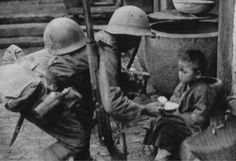Japanese soldier giving food to a children (1939)