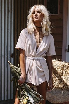 The Suede Plunge Playsuit is made from a soft, faux suede fabric in a dusty musk hue. It features a deep plunging neckline, split overlay detailing in shorts and long wrap drawstring at waist. Complete the look with layered necklaces and strappy heels. By SABO LUXE.