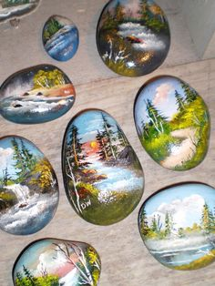 Beautiful landscapes painted on rocks.