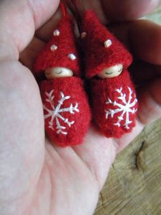 These sweet snowflake ornaments will be a beautiful addition to your handmade holiday ornament collection. Perfect for gift giving too! They are red wool with white embroidered snowflakes & little dots representing snow on their cute gnome hats. They are hand stitched using quality materials including thick, upcycled wool felt, wooden peg doll, glue, thread, pencil & AP certified non-toxic finish for the face. They hang by red, variegated embroidery thread. These ornaments are sold as a…