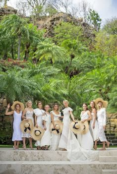 Mollie Ruprecht and her bridesmaids wearing white gowns and matching straw sun hats