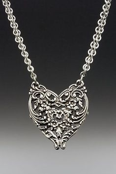 This necklace was handmade from antique spoon patterns from the 1800s. The silver plate heart hangs on an adjustable rolo chain with lobster clasp closure. Length adjusts from 16 to 18 inches. Pendant
