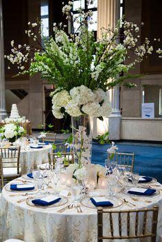 Elegant, tall, white hydrangea centerpiece  Floral and Decor by Southern Event Planners
