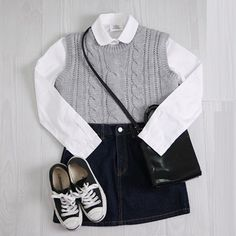 Monochromatic look with the white collared button up, grey knit fest, denim skirt, black converse, and a black cross body.