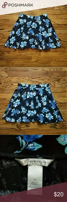 "LC Lauren Conrad black skater skirt size medium LC Lauren Conrad black skater skirt with varying shades of blue flowers. Fabric covered elastic waistband. Perfect for layering over tights for fall. Measurements are approx 28"" waist, 16"" length. 95% cotton, 5% spandex. Excellent used condition. LC Lauren Conrad Skirts Circle & Skater"