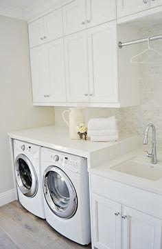white laundry room, carrara marble, hang bar, sink