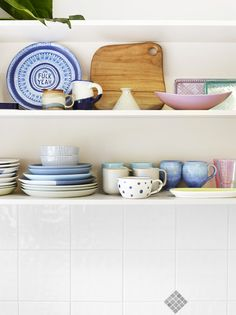 Kitchen detail.  Top left – Lucas Grogan plate, local pottery, Country Road mugs and bowls, op shop finds.  Photo - Toby Scott, production – Lucy Feagins / The Design Files.