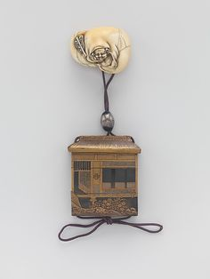 Case (Inrô) Shaped as a House with Design of Window, Fence, Flowers Period: Edo period (1615–1868) Date: 18th–19th century Culture: Japan Medium: Lacquer, fundame, nashiji, gold, black and silver hiramakie; Interior: nashiji and fundame