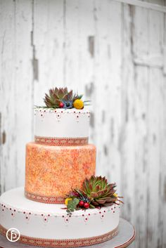 Stunning southwestern style wedding cake. Floral by Andrea K. Grist Floral.  Photograph by Freeland Photography. | Kansas City Wedding Cakes |