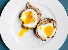 Soft-Boiled Scotch Eggs | This soft-boiled approach to the common party dish Scotch Eggs presents an unexpectedly tender egg yolk within a crispy exterior. Get the recipe at Food & Wine.