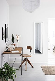 work space with white walls and floors.
