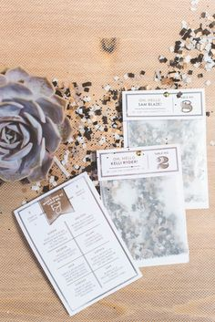 escort cards do triple duty holding confetti and ice breaker fun facts about the people at your table.
