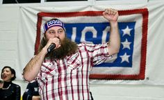 "Willie Robertson of A&E's hit show ""Duck Dynasty"" entertains the #troops with a little help from singer/songwriter Bridget Kelly during a 2013 USO tour."