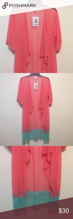 """LuLaRoe Monroe Coral Fringed Kimono NWT - Sheer coral fabric with a beautiful floral pattern. Mint fringed bottom. Perfect for a swimsuit coverup. Small pin sized hole in upper right (pictured). Does not ruin it in anyway.   Length: approx 38 1/2"""" LuLaRoe Swim Coverups"""