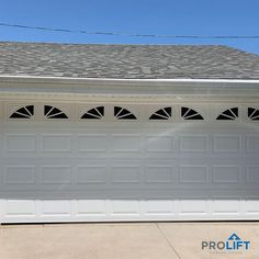 Street-facing garage doors take up a large percentage of a home's facade (often 30% to 40%) so many homeowners include windows to (1) break up an otherwise 'blocky' appearance of two single doors or one double and (2) to better integrate the garage into the rest of the home's exterior look. (3) add extra style! Shown here: White insulated steel garage door with short panels and a starburst window pattern. | ProLift Garage Doors on Houzz | Project and Photo Credits: ProLift Garage Doors…