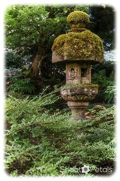 """Stone lanterns in Butchart Gardens - the Japanese Garden. The bottom touching the earth represents """"chi"""", the part just above is """"sui"""" or water. """"Ka"""" (fire) is around the flame, and above that is air """"fu"""" and spirit """"ku"""" at the very top. Stone lanterns are wonderful photography subjects with the textures of stone and moss."""