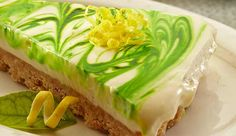 This light, limey pie has a cheesecake feel to it and is the perfect summer dessert. The citric punch of the lime cuts down the creaminess of the filling and leaves a lingering desire for another bite. This is an extraordinarily simple, no bake recipe. Swirl a few drops of green food colouring on top for added glamour.