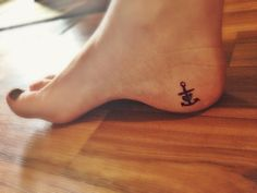 Heart, cross, anchor tattoo