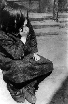Lodz, Poland, A girl on a street in the ghetto. Mendel Grosman
