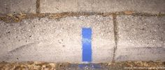 Soon You May See This Thin Blue Line Pop Up On a Curb In Your Neighborhood. Here's What It Means.