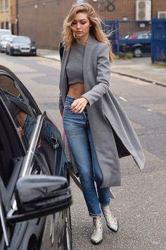 On Hadid: Lavish Alice Contrast Duster Coat ($132); Lavish Alice Grey Crop Top($77); denim; and Zadig & Voltaire Mods Fashion Show Boots($910).