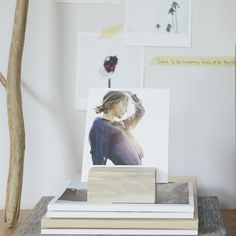 Love this wood photo block instead of a picture frame. Comes with 12 of your favorite photos too.