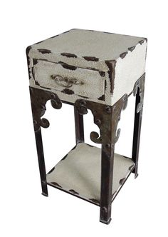 Distressed one-drawer end table with an open bottom shelf and scrollwork apron detail. Product: End tableConstruction Material: MetalColor: Antique whiteFeatures: One drawerVintage feelDimensions: H x W x D Primitive Furniture, Funky Furniture, Handmade Furniture, Refinished Furniture, Rustic Furniture, Luxury Furniture Brands, Buy Furniture Online, Eclectic Decor, Modern Decor