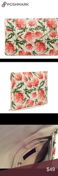 """Oversized Floral Straw Clutch With Removable Chain Absolutely beautiful floral envelope clutch/crossbody with straw exterior, fabric lining and gold detachable chain strap. Zippered closure and zippered interior pocket. Perfect for spring and summer!   13 1/2"""" wide 10"""" tall 21"""" strap drop Pink Haley Bags Clutches & Wristlets"""