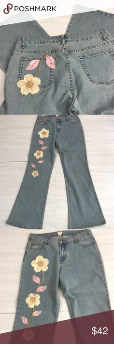 Cache boho festival jeans embroidered flare 12 Cache high waisted jeans size 12. The color is faded blue. There is a flower on the front right that is embroidered and embellished with sequins. There is also another embroidered and appliquéd flower on the back left pocket. These jeans are in perfect condition. Please see pictures for details. Cache Jeans Flare & Wide Leg