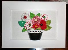 Flores de fuxico no mini quadrinho de parede