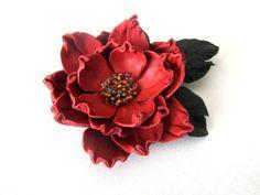 Handmade genuine leather flower brooch in orange color-leather flower in red-flower brooch. $18.00, via Etsy.