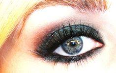 Dark green shimmery eye makeup by Tiffany D.