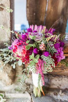 Photo: Lauren Fair Photography; Vibrant Outdoor Pennsylvania Wedding at the Spring Hills Farm from Lauren Fair Photography - bridal bouquet