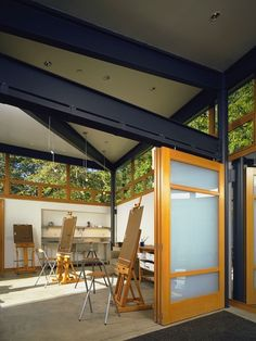 , Industrial Home Office For Painter Or Designer With Comely Glass Sliding Partition Doors With Burn Orange Wooden Frame Also Rustic Armchairs Also Black Stainless Steel Building Frame Also Cream Concrete Floor: Kinds of Interior Sliding French Doors
