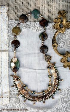Multi-strand necklace with jasper, carved mother of pearl roses and a mix of pearls - by Cindy Wimmer.