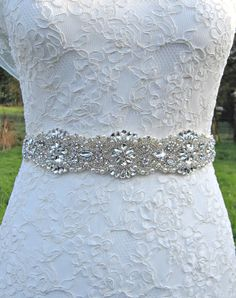This sash is truly stunning and would add the perfect finishing touch to your wedding dress. Vintage inspired, and studded with scores of high quality rhinestone crystals and pearls, this belt glitters, gleams and catches the light making it a real show stopper. The rhinestones are securely attached to double sided satin ribbon for a really high quality feel. You can choose your own ribbon colour for your sash from picture 5.  IMPORTANT INFORMATION:  Length of applique: 13 inches / 33cm…
