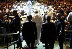 Pope Francis entered the General Assembly room illuminated by a spotlight Friday morning at the organization's headquarters in NYC