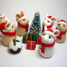 Santa Mice are out in force this festive season, and they'll be travelling around the world with their Reindeer Mice and tiny sleigh to give out presents to all the good boys and girls - will you be one of the lucky ones they visit? Wee Santa Mice are . Christmas Cake Topper, Christmas Cake Decorations, Christmas Cupcakes, Noel Christmas, Christmas Crafts, Wedding Cakes With Cupcakes, Fondant Cupcakes, Fondant Animals, Polymer Clay Christmas