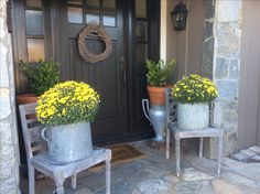 Brighten up your entry with Fall flowers.