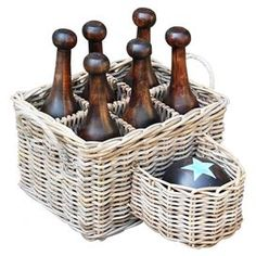 Eight-piece bowling set with a teak wood ball and six teak wood pins. Includes handmade wicker basket.  Product: Ball, 6 pins and basketConstruction Material: Teak wood and wickerColor: Grey Features: Handmade basketDimensions: 16.5 H x 20.5 W x 19 D (basket)Cleaning and Care: Remove dust with a soft, lint free cloth