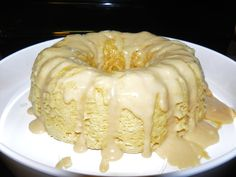 Vanilla Caramel Cake with Caramel Cream Cheese Drizzle    1 box white cake mix (one day I will make cake from scratch)  Follow directions on box then add-    2 Tbsp Sour Cream  2 Tbsp Maxwell House international Vanilla Caramel latte  1 lg. Package vanilla pudding mix  1 Tbsp Caramel sauce    Mix well. Use silicone brush to brush vegetable oil around Pampered Chef Stoneware Fluted pan. Pour in batter then drizzle with caramel sauce (about 1/2 cup) Bake in microwave for 10-11 minutes (cake…