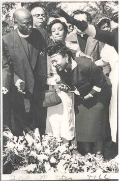 murder victim Emmett Till's mother at her son's funeral.  Years after his gruesome death during a visit with relatives in Mississippi, the white female who'd accused the Chicago youngster of grossly inappropriate behavior admitted she'd lied about that to her husband, Till's murderer, and to the MS court that let him off.