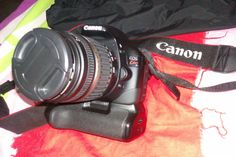 Canon 550D Kiss X4 Digital with Battery Grip & 3.5 18-200 lens