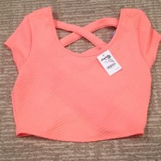 SALE❗️CRISS CROSS BACK CROP TOP Lovely peach crop top with fun and funky CRISS cross back! Fun and unique piece that will look great with anything! Brand new-never worn! SMOKE FREE HOME FAST SHIPPING! Charlotte Russe Tops Crop Tops