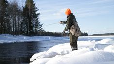 Winter fishing for trout, fly fishing.