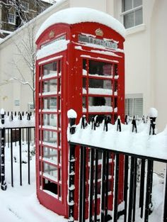 London telephone booth in the snow - loved London... remember it vividly... would love to go back :)