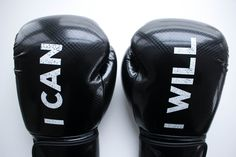 Women's black kickboxing gloves. I can I will Watch me slogan written on the gloves. Be a bad ass with these gloves. https://mymantraactive.com/collections/accessories/products/pre-order-black-boxing-gloves