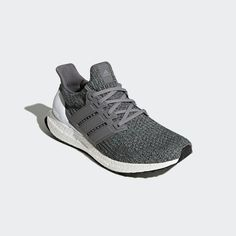 Log miles on city streets in the Ultraboost shoes. Built with a sock-like adidas Primeknit upper that adapts to every footstrike, these men's running shoes harness the power of Boost to provide an energy-returning ride from push-off to touchdown. The molded heel allows the Achilles to move naturally and comfortably over the miles, while a midfoot cage ensures a locked-down fit. A super-grippy outsole offers superior traction in wet or dry conditions.
