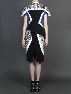 Sleek designs w/ Peter Pilotto padded shoulder shortsleeved dress with concealed back zip closure and sash panel skirt